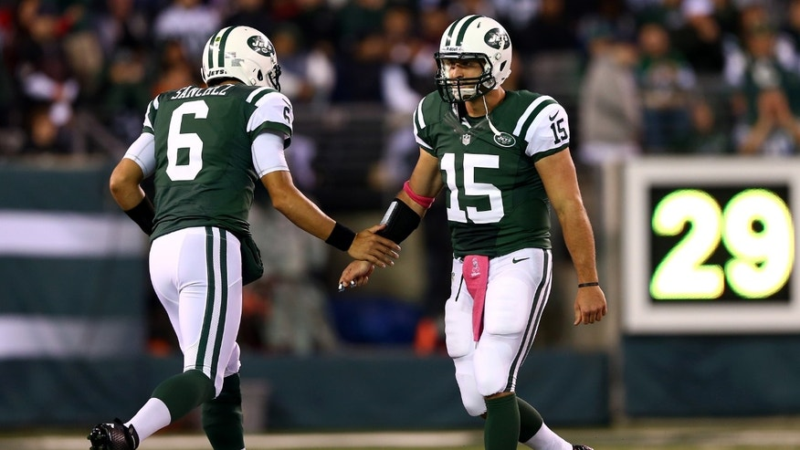 EAST RUTHERFORD, NJ - OCTOBER 08:  Quarterback Mark Sanchez #6 of the New York Jets re-enters the game to replace Tim Tebow #15 in the first quarter against the Houston Texans at MetLife Stadium on October 8, 2012 in East Rutherford, New Jersey.  (Photo by Elsa/Getty Images)