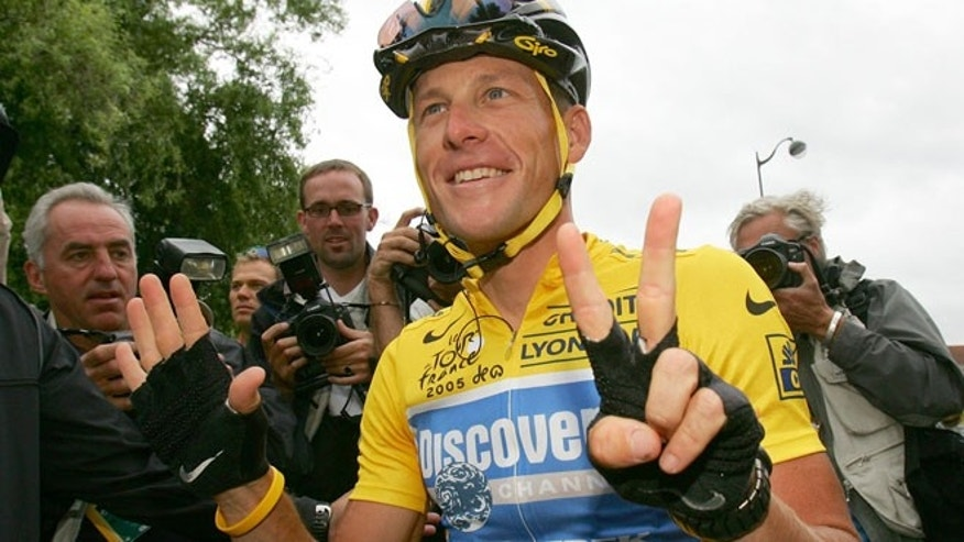 This july 24, 2005 file photo shows overall leader Lance Armstrong signaling seven for his seventh straight win in the Tour de France cycling race, at the start of the 21st and final stage of the race.