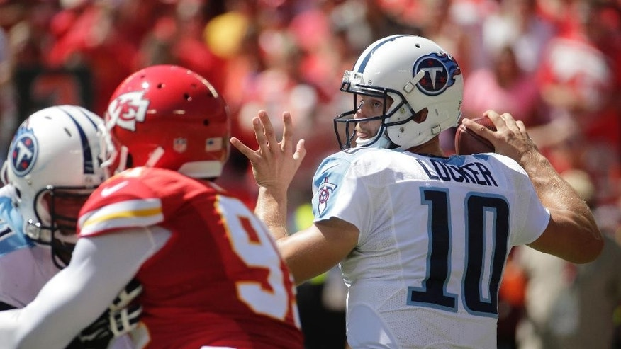 Tennessee Titans quarterback Jake Locker (10) throws in the first half of an NFL football game against the Kansas City Chiefs in Kansas City, Mo., Sunday, Sept. 7, 2014. (AP Photo/Charlie Riedel)