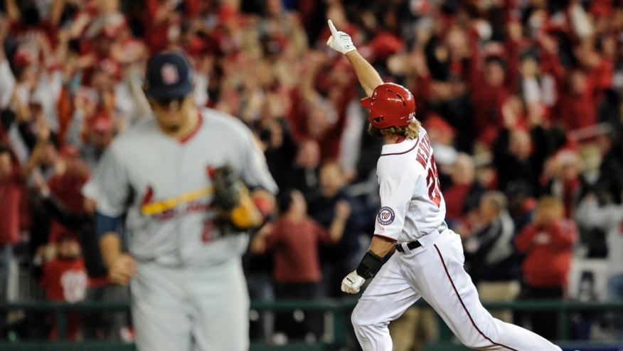 Oct. 11, 2012: Washington Nationals' Jayson Werth, right, reacts as he rounds the bases after hitting the game-winning solo home run in the ninth inning of Game 4 of the National League division baseball series against the St. Louis Cardinals in Washington. Washington won 2-1.