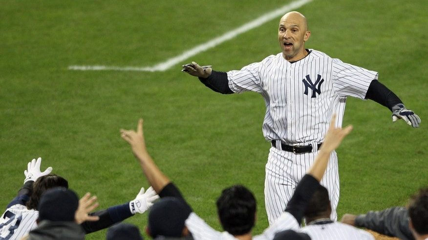 NEW YORK, NY - OCTOBER 10: Raul Ibanez #27 of the New York Yankees reaches his teammates at home place after hitting a walk off home run in the bottom of the twelfth inning against the Baltimore Orioles  in Game Three of the American League Division Series at Yankee Stadium on October 10, 2012 in the Bronx borough of New York City.  (Photo by Alex Trautwig/Getty Images)