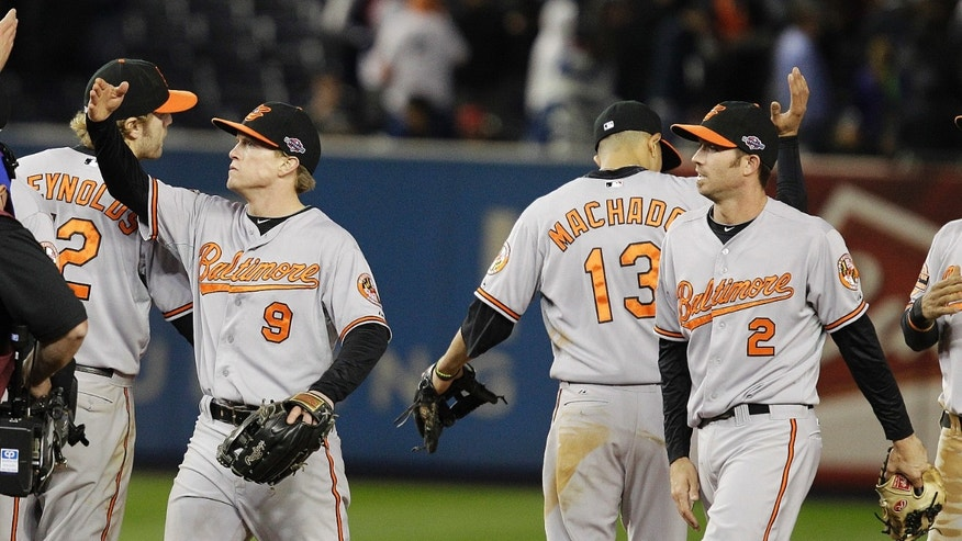 Oct. 11, 2012: Baltimore Orioles' Nate McLouth (9) and J.J. Hardy (2) celebrate with teammates after Game 4 of the American League division baseball series against the New York Yankees late Thursday.