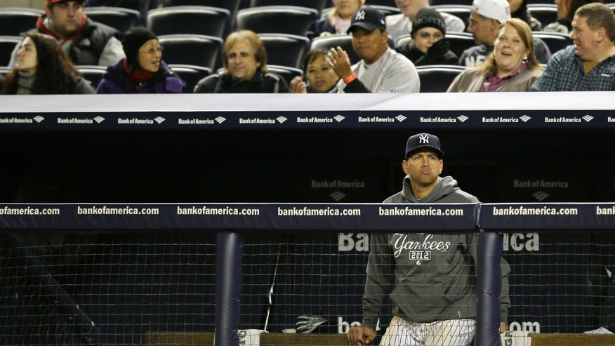 Oct. 13, 2012: New York Yankees&#39&#x3b; Alex Rodriguez watches from the bench in the ninth inning of Game 1 of the American League championship series against the Detroit Tigers in New York.
