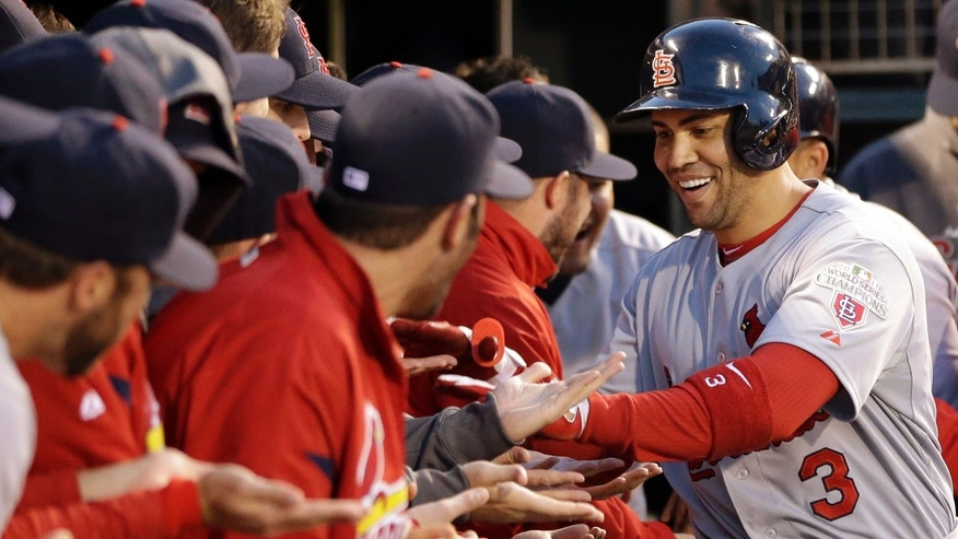 St. Louis Cardinals' Carlos Beltran (3) is congratulated in the dugout after hitting a two-run home run during the fourth inning in Game 1 of baseball's National League championship series against the San Francisco Giants Sunday, Oct. 14, 2012, in San Francisco. (AP Photo/David J. Phillip)