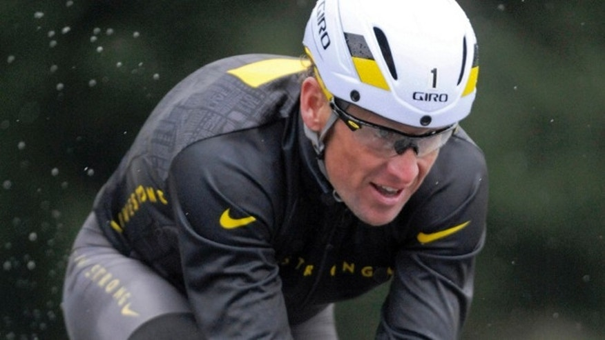 Oct. 7, 2012: Lance Armstrong competes in the Rev3 Half Full triathalon in Ellicott City, Md.