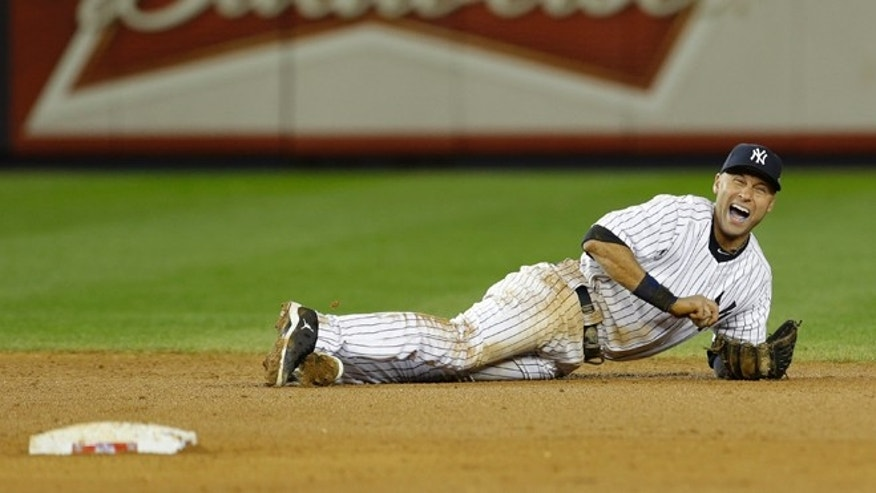 Oct. 14, 2012: New York Yankees shortstop Derek Jeter reacts after injuring himself in the 12th inning of Game 1 of the American League championship series against the Detroit Tigers in New York.