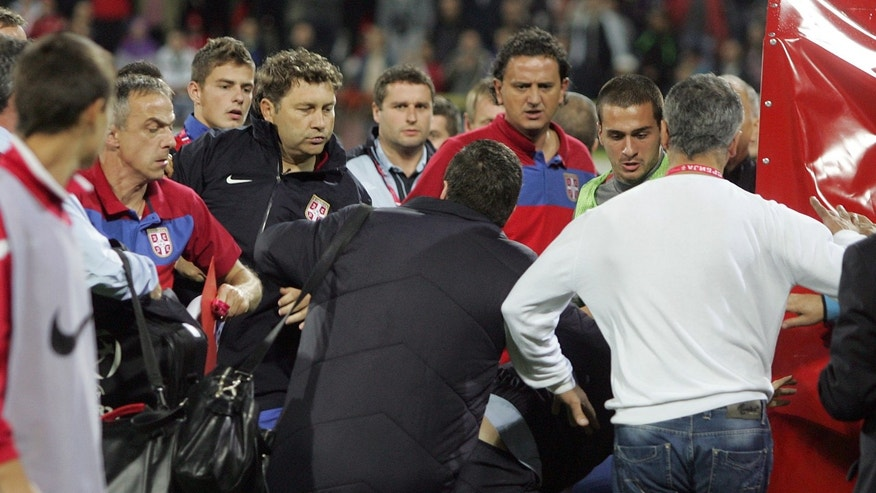 Serbian players, in red and green, clash with England players after their 2013 European Under-21 Championship play-off, second leg match, between Serbia and England, in Krusevac, Serbia.