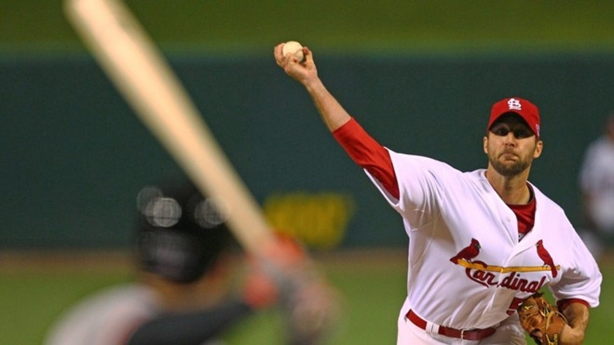 Oct. 18, 2012: St. Louis Cardinals starting pitcher Adam Wainwright throws during the first inning of Game 4 of baseball's National League championship series against the San Francisco Giants in St. Louis.