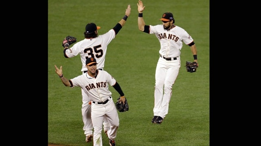 Oct. 21, 2012: San Francisco Giants' Brandon Crawford (35), Angel Pagan, right, and Gregor Blanco celebrate after Game 6 of baseball's National League championship series against the St. Louis Cardinals in San Francisco. The Giants won 6-1 to tie the series at 3-3.
