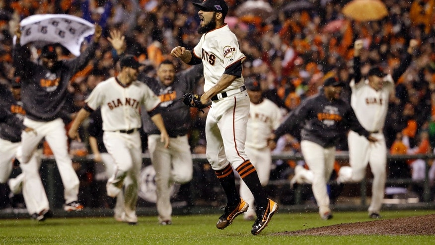 Oct. 22, 2012: San Francisco Giants relief pitcher Sergio Romo reacts after the final out in Game 7 of baseball's National League championship series against the St. Louis Cardinals in San Francisco. The Giants won 9-0 to win the series.