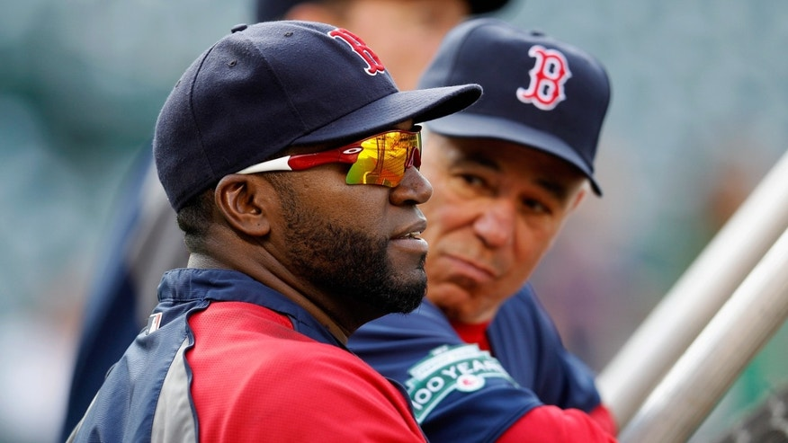 BALTIMORE, MD - MAY 22:  Manager Bobby Valentine (R) and David Ortiz #34 of the Boston Red Sox look on during batting practice before the start of the Red Sox game against the Baltimore Orioles at Oriole Park at Camden Yards on May 22, 2012 in Baltimore, Maryland.  (Photo by Rob Carr/Getty Images)