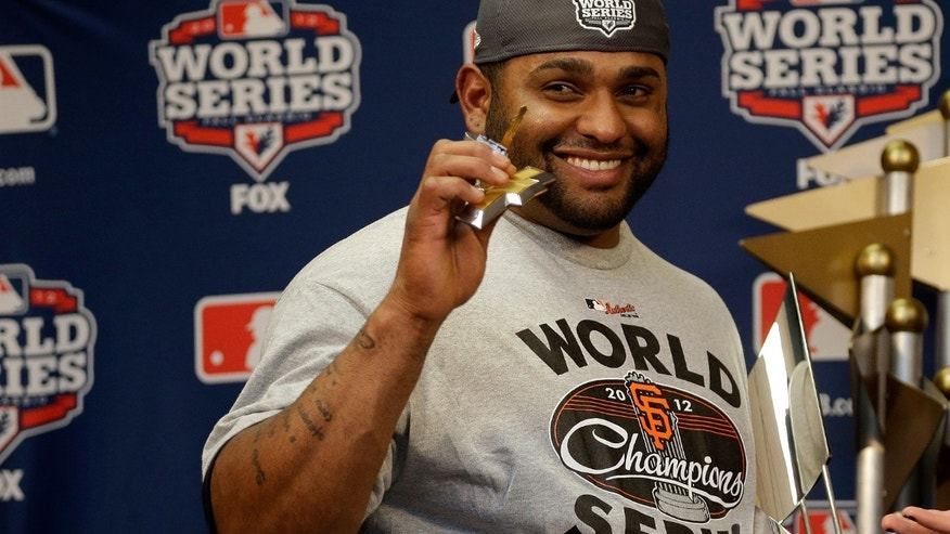 Pablo Sandoval #48 of the San Francisco Giants poses with the Most Valuable Player Trophy after Game Four of the Major League Baseball World Series at Comerica Park on October 28, 2012 in Detroit, Michigan.