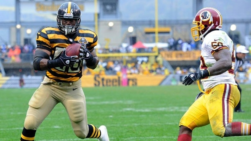 Oct. 28, 2012: Pittsburgh Steelers fullback Will Johnson (46) makes a catch past Washington Redskins inside linebacker London Fletcher (59) for a touchdown in the third quarter of an NFL football game in Pittsburgh.