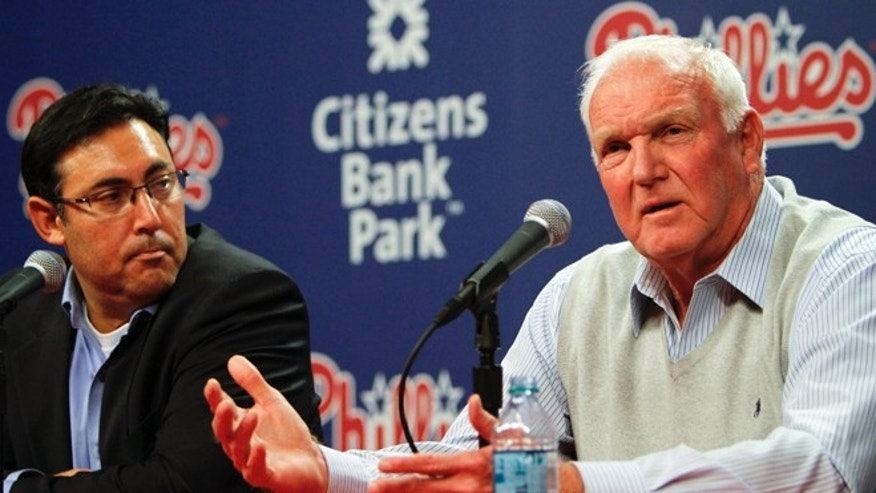 Philadelphia Phillies manger Charlie Manuel, right, speaks to members of the news media during a news conference on Thursday Oct. 4, 2012, in Philadelphia.  Senior vice president and general manager Ruben Amaro Jr.,left, looks on.  (AP Photo/ Joseph Kaczmarek)