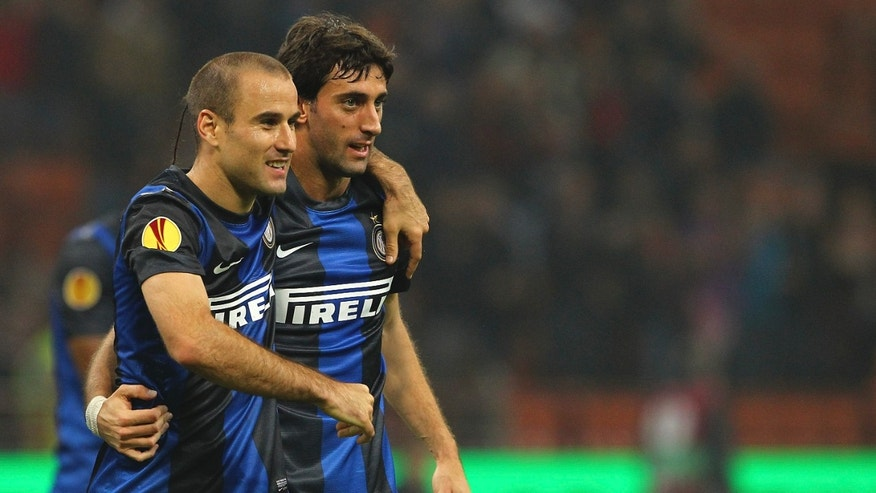 Oct.25, 2012: Rodrigo Palacio (L) of FC Internazionale Milano celebrates with his team-mate Diego Alberto Milito (R) after scoring the opening goal during the UEFA Europa League group H match between FC Internazionale Milano and  FK Partizan in Milan, Italy.