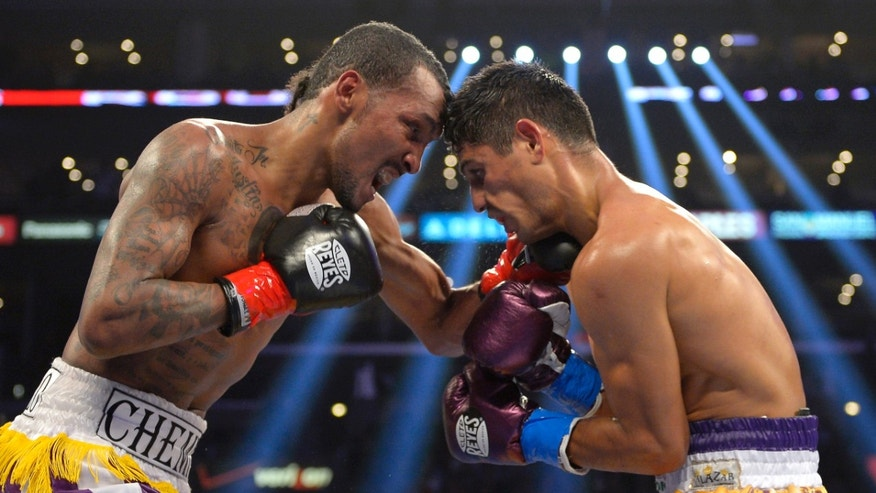 Anselmo Moreno, left, of Panama connects with Abner Mares during their WBC super bantamweight title bout, Saturday, Nov. 10, 2012, in Los Angeles. Mares won the fight by unanimous decision. (AP Photo/Mark J. Terrill)