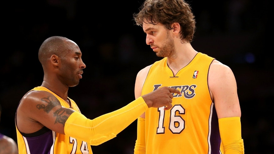 Kobe Bryant #24 and Pau Gasol #16 of the Los Angeles Lakers confer during the game with the Sacramento Kings at Staples Center on October 21, 2012 in Los Angeles, California.  (Photo by Stephen Dunn/Getty Images)