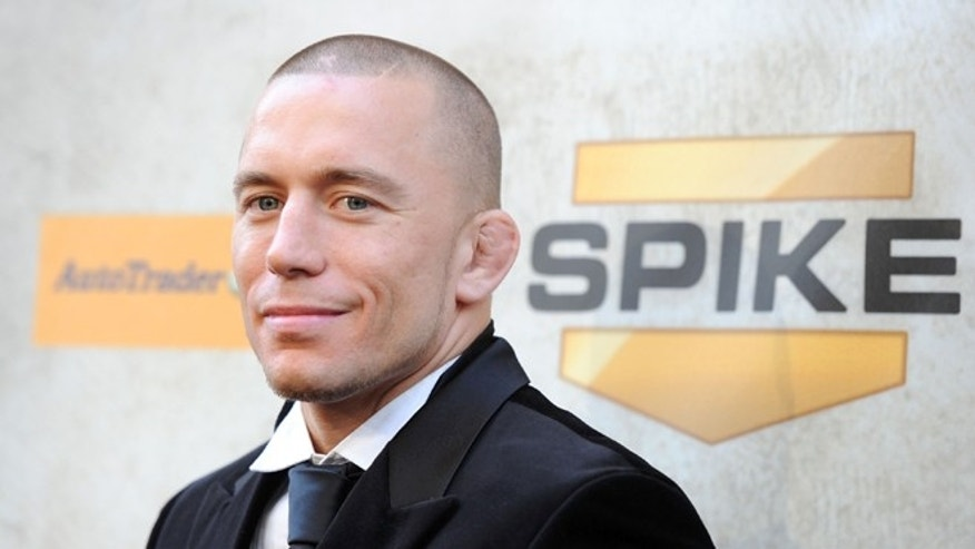 "LOS ANGELES, CA - JUNE 05:  UFC Welterweight Champion Georges St-Pierre arrives at Spike TV's 4th Annual ""Guys Choice Awards"" held at Sony Studios on June 5, 2010 in Los Angeles, California.  (Photo by Frazer Harrison/Getty Images)"