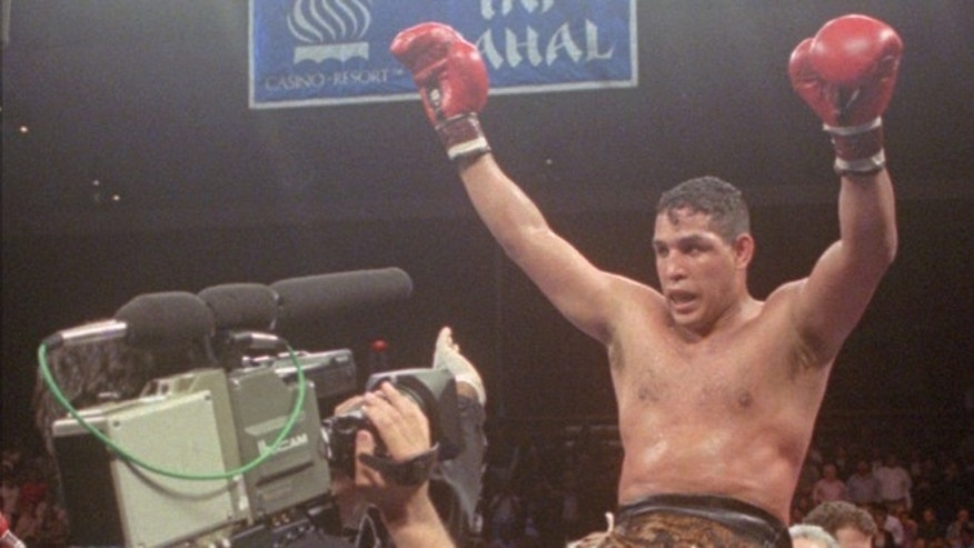 "June 22, 1996: This file photo shows Hector ""Macho"" Camacho being lifted into the air after his unanimous decision over Roberto Duran in an IBC middleweight title fight at the Trump Taj Mahal Casino Resort in Atlantic City, N.J."