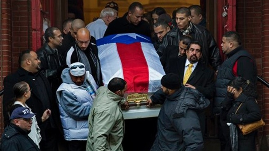 "Hector ""Macho"" Camacho's casket is brought down the steps of St. Cecilia's Roman Catholic Church in New York after his funeral Saturday, Dec. 1, 2012. (AP Photo/Craig Ruttle)"