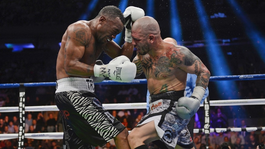 Austin Trout, left, and Miguel Cotto of Puerto Rico face off in the 11th round of their WBA super welterweight title fight at Madison Square Garden in New York, Saturday, Dec. 1, 2012. Trout won the 12-round boxing match in a unanimous decision. (AP Photo/Henny Ray Abrams)