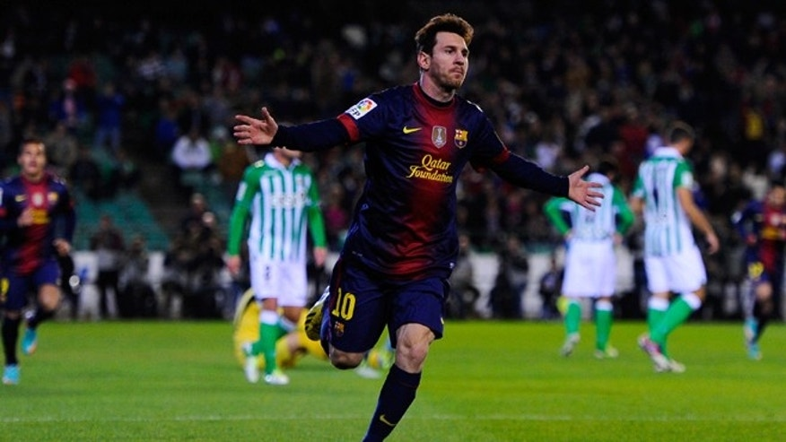 SEVILLE, SPAIN - DECEMBER 09:  Lionel Messi of FC Barcelona celebrates after scoring the opening goal during the La Liga match between Real Betis Balompie and FC Barcelona at Estadio Benito Villamarin on December 9, 2012 in Seville, Spain.   (Photo by David Ramos/Getty Images)
