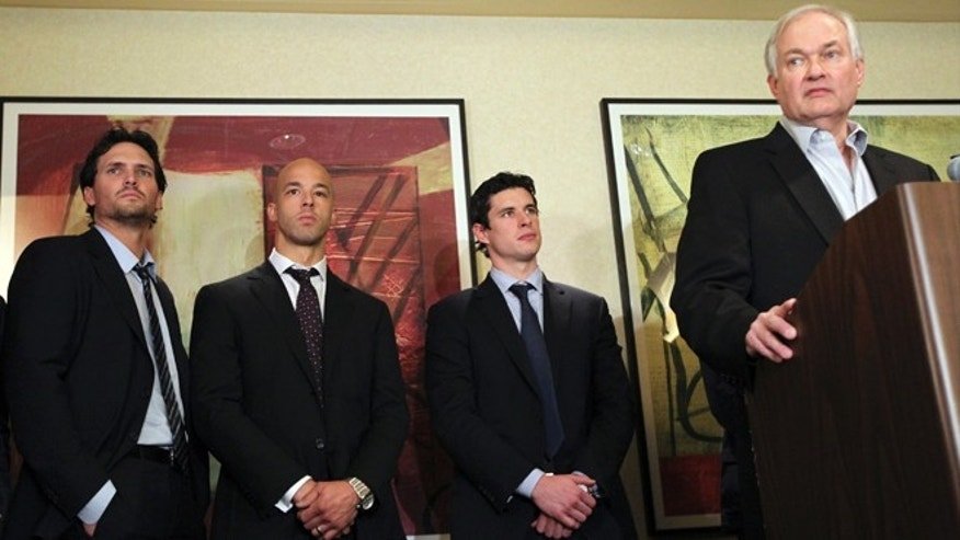 Dec. 6, 2012: Winnipeg Jets' Ron Hainsey, left, Vancouver Canucks' Manny Malhotra, second from left, and Pittsburgh Penguins' Sidney Crosby, second from right, listens as Don Fehr, right, executive director for the National Hockey League Players Associations, speaks to reporters in New York.