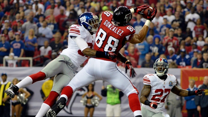 Atlanta Falcons tight end Tony Gonzalez (88) makes a catch in the end zone for a touchdown as New York Giants defensive back Will Hill (31) and strong safety Stevie Brown (27) defend during the first half of an NFL football game, Sunday, Dec. 16, 2012, in Atlanta. (AP Photo/Rich Addicks)