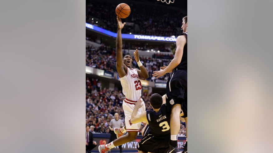 Butler guard Alex Barlow (3) draws the charge from Indiana guard Remy Abell during the second half of an NCAA college basketball game in Indianapolis, Saturday, Dec. 15, 2012. Butler defeated No. 1 Indiana 88-86 in overtime. (AP Photo/Michael Conroy)