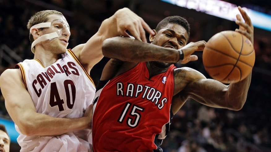Cleveland Cavaliers' Tyler Zeller (40) battles Toronto Raptors' Amir Johnson (15) for a rebound in the first quarter of an NBA basketball game, Tuesday, Dec. 18, 2012, in Cleveland. (AP Photo/Mark Duncan)