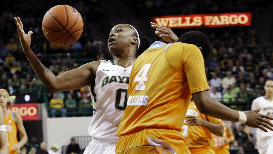 Baylor's Odyssey Sims (0) drives against Tennessee's Kamiko Williams (4) during the first half of an NCAA college basketball game, Tuesday, Dec. 18, 2012, in Waco, Texas. (AP Photo/LM Otero)