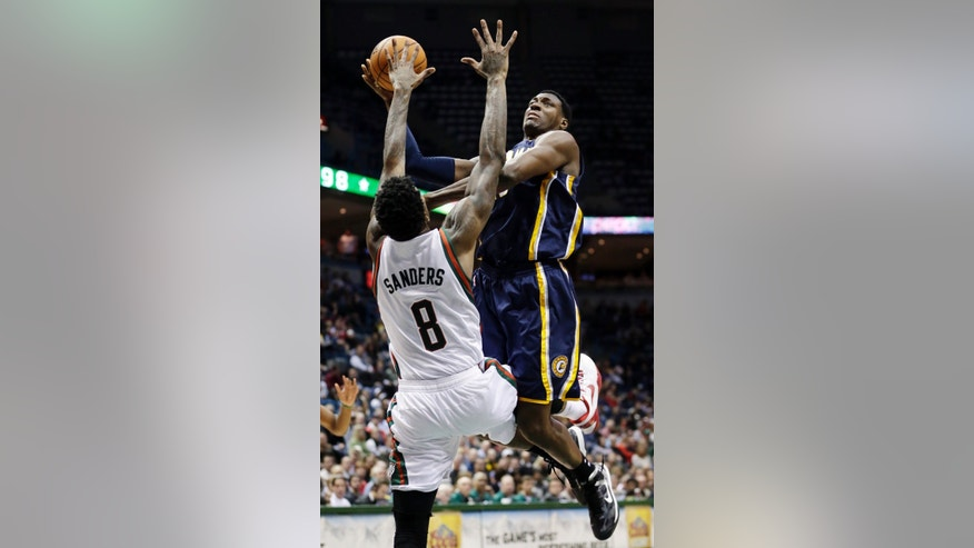Indiana Pacers' Ian Mahinmi shoots over Milwaukee Bucks' Larry Sanders (8) during the second half of an NBA basketball game Tuesday, Dec. 18, 2012, in Milwaukee. The Bucks won 98-93. (AP Photo/Morry Gash)