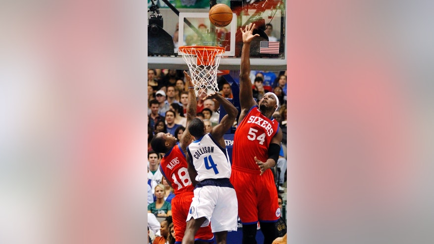 Dallas Mavericks guard Darren Collison (4) shoots as Philadelphia 76ers guard Maalik Wayns (18) and center Kwame Brown (54) defend during the first half of an NBA basketball game, Tuesday, Dec. 18, 2012, in Dallas. (AP Photo/John F. Rhodes)