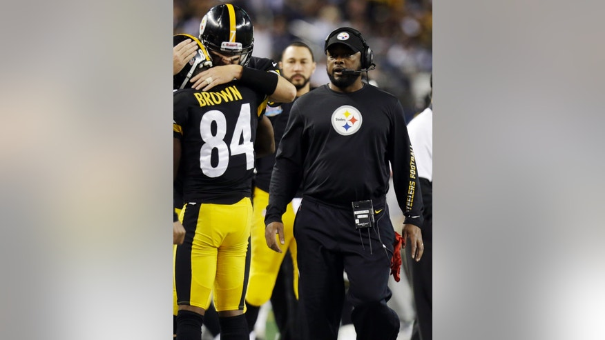 Pittsburgh Steelers head coach Mike Tomlin walks the sideline during the second half of an NFL football game against the Dallas Cowboys Sunday, Dec. 16, 2012 in Arlington, Texas. (AP Photo/LM Otero)