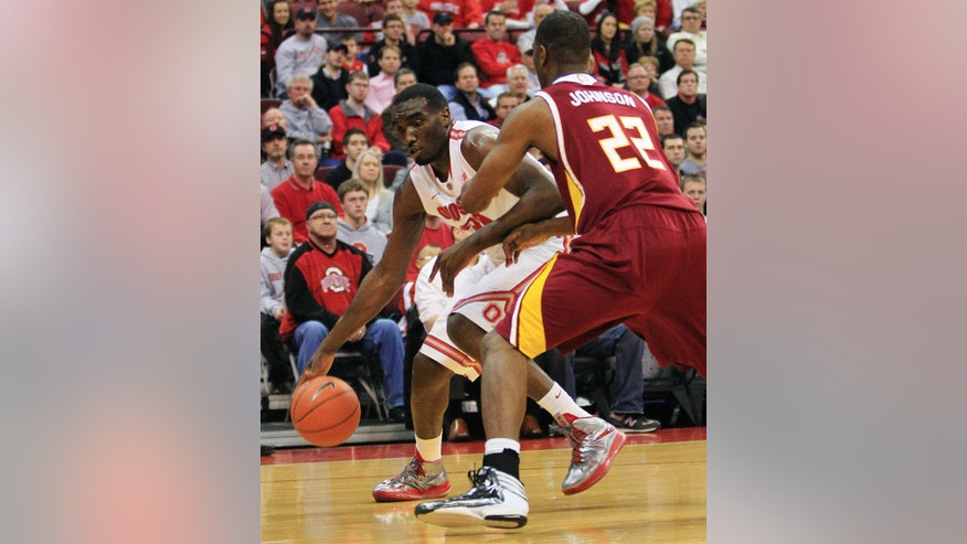 Ohio State's Evan Ravenel, left, drives the baseline against Winthrop's Steve Johnson during the first half of an NCAA college basketball game, Tuesday, Dec. 18, 2012, in Columbus, Ohio. (AP Photo/Jay LaPrete)