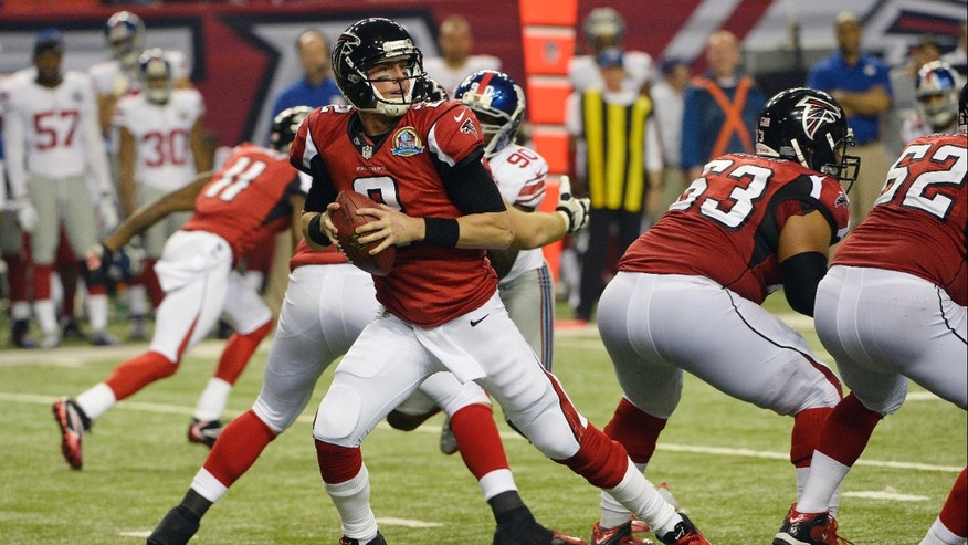 Atlanta Falcons quarterback Matt Ryan (2) works against the New York Giants during the second half of an NFL football game on Sunday, Dec. 16, 2012, in Atlanta. (AP Photo/Rich Addicks)