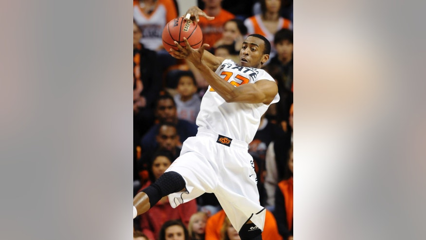 Oklahoma State guard Markel Brown steals the ball during the first half of an NCAA college basketball game against Texas-Arlington in Stillwater, Okla., Wednesday, Dec. 19, 2012. (AP Photo/Brody Schmidt)