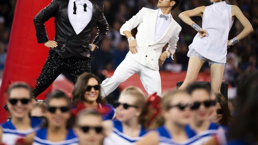 "South Korean entertainer Psy performs the song ""Gangnam Style"" during halftime of an NFL football game between the Buffalo Bills and Seattle Seahawks, Sunday, Dec. 16, 2012, in Toronto. (AP Photo/The Canadian Press, Nathan Denette)"
