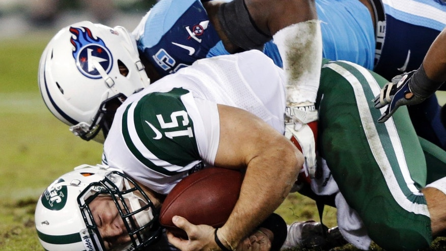 New York Jets quarterback Tim Tebow (15) is sacked for a 2-yard loss by Tennessee Titans linebacker Zach Brown (55) in the second quarter of an NFL football game, Monday, Dec. 17, 2012, in Nashville, Tenn. (AP Photo/Wade Payne)