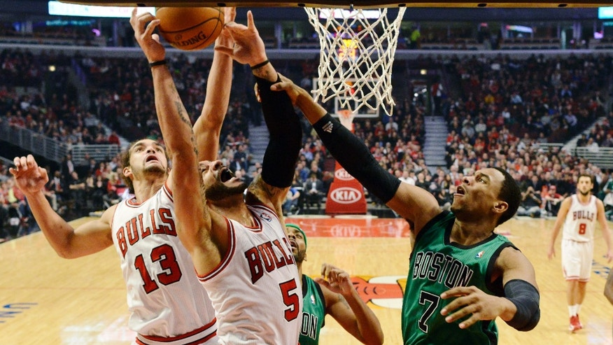 Chicago Bulls center Joakim Noah (13), forward Carlos Boozer (5) and Boston Celtics forward Jared Sullinger (7) compete for a rebound during the first half of an NBA basketball game, Tuesday, Dec. 18, 2012, in Chicago. (AP Photo/Brian Kersey)