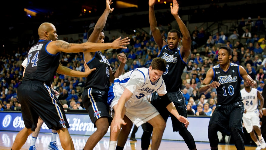 Creighton's Doug McDermott (3), center, loses control of the ball against, from left to right, Tulsa's Scottie Haralson (34), Kauri Black (0), Tim Peete (5) and James Woodard (10) defend in the first half of an NCAA college basketball game in Omaha, Neb., Wednesday evening, Dec. 19, 2012. (AP Photo/The Omaha World-Herald/Rebecca S. Gratz)  MAGAZINES OUT; ALL LOCAL TV OUT