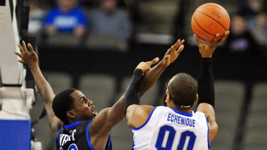 Tulsa's D'Andre Wright (40) tries to block a shot by Creighton's Gregory Echenique (00) during their NCAA college basketball game, Wednesday, Dec. 19, 2012, in Omaha, Neb. (AP Photo/Dave Weaver)