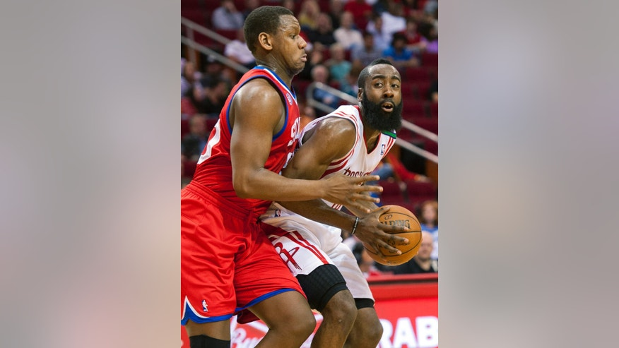 Philadelphia 76ers' Lavoy Allen, left, defends against Houston Rockets' James Hardin, right, during the first quarter of an NBA basketball game, Wednesday, Dec. 19, 2012, in Houston. (AP Photo/Dave Einsel)