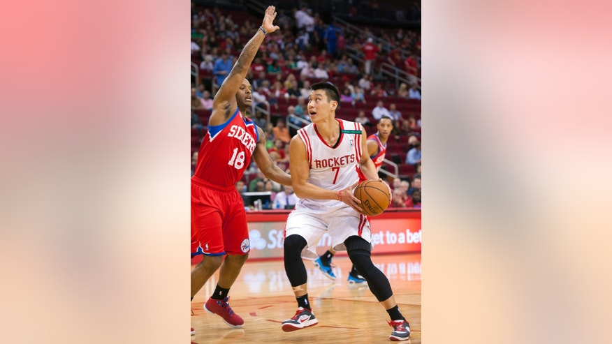 Houston Rockets' Jeremy Lin (7) drives against Philadelphia 76ers' Maalik Wayns (18) during the first quarter of an NBA basketball game, Wednesday, Dec. 19, 2012, in Houston. (AP Photo/Dave Einsel)