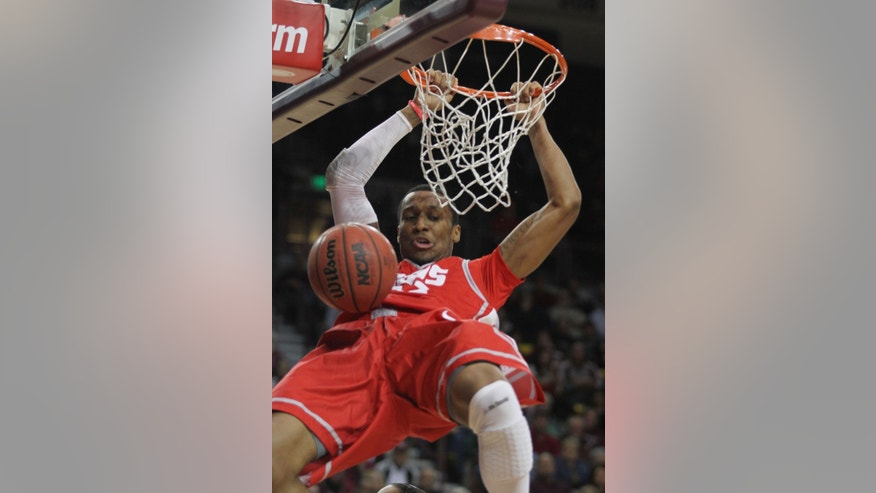 New Mexico's Nick Banyard slam dunks against New Mexico State during the second half of an NCAA college basketball game in Las Cruces, N.M., Wednesday Dec. 19, 2012. (AP Photo/Victor Calzada)