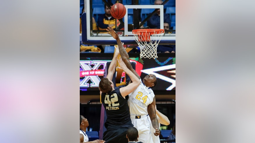Oakland's Corey Petros (42) shoots over West Virginia's Aaric Murray (24) during the first half of an NCAA college basketball game, Wednesday, Dec. 19, 2012, in Morgantown, W.Va. (AP Photo/David Smith)