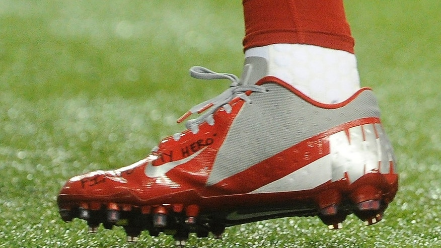Dec. 16, 2012: A shoe worn by New York Giants wide receiver Victor Cruz bears a message dedicated to 6-year-old Jack Pinto, one of the victims in last week's school shootings at Sandy Hook Elementary School in Newtown, Conn., as Cruz warms up for the Giants' NFL football game against the Atlanta Falcons in Atlanta.