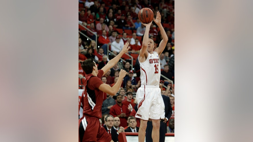 North Carolina State's Scott Wood goes up a 3-point shot over Stanford's Rosco Allen during the first half of an NCAA college basketball game in Raleigh, N.C., Tuesday, Dec. 18, 2012. (AP Photo/Gerry Broome)