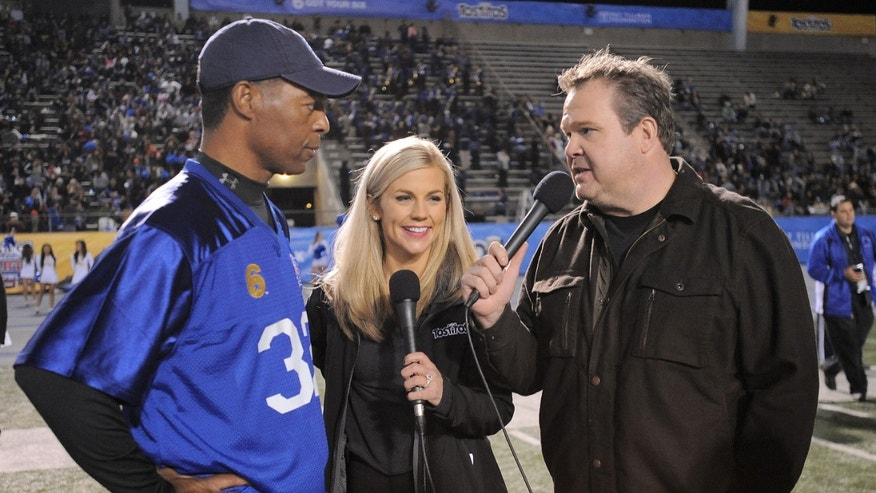 "IMAGE DISTRIBUTED FOR TOSTITOS:  From left, former NFL player Marcus Allen, sportscaster Samantha Steele and actor Eric Stonestreet joined the ""Tostitos Homecoming Party Bowl"" hosted at Cerritos College on Thursday, December 13, 2012 in Norwalk, Calif. The Tostitos brand surprised 28 unsuspecting veterans with the ultimate football party and star-studded event that included football greats, Bobby Bowden, Marcus Allen and actor/screenwriter, Owen Wilson. (Photo by Jordan Strauss/Invision for Tostitos/ AP Images)"