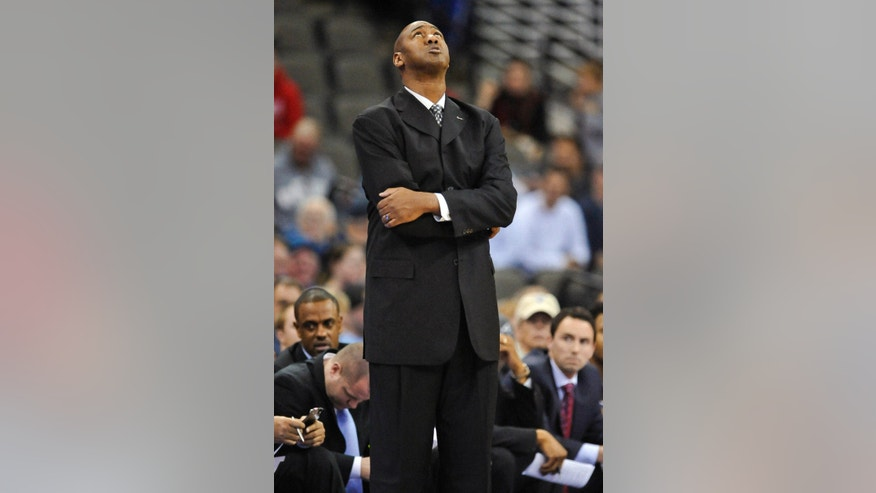 Tulsa's Danny Manning looks at the scoreboard during their Wednesday, Dec. 19, 2012, NCAA college basketball game against Creighton in Omaha, Neb. (AP Photo/Dave Weaver)
